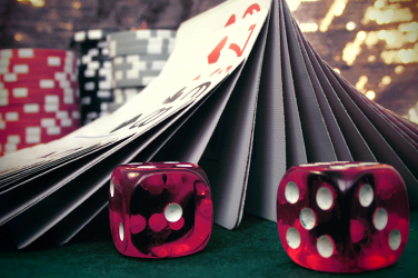 casino table with dices and cards